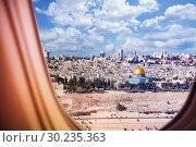 Купить «Israel Jerusalem city view from plane window», фото № 30235363, снято 21 августа 2015 г. (c) Сергей Новиков / Фотобанк Лори