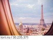 Купить «Paris and Eiffel tower view from plane window», фото № 30235371, снято 21 августа 2015 г. (c) Сергей Новиков / Фотобанк Лори