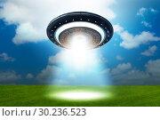 Illustration of flying saucer emitting light - 3d rendering. Стоковое фото, фотограф Elnur / Фотобанк Лори