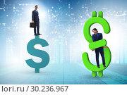 Купить «Businessman in dollar and debt concept», фото № 30236967, снято 18 марта 2019 г. (c) Elnur / Фотобанк Лори