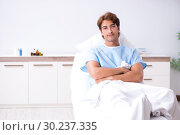 Купить «Young male patient lying on couch in hospital», фото № 30237335, снято 2 октября 2018 г. (c) Elnur / Фотобанк Лори