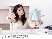 Купить «Young woman with receipts in budget planning concept», фото № 30237779, снято 13 ноября 2018 г. (c) Elnur / Фотобанк Лори