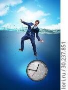Купить «Businessman in deadline and time management concept», фото № 30237851, снято 19 марта 2019 г. (c) Elnur / Фотобанк Лори