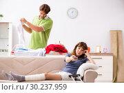 Купить «Husband helping leg injured wife in housework», фото № 30237959, снято 4 октября 2018 г. (c) Elnur / Фотобанк Лори
