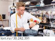 Купить «Male fashion designer at work», фото № 30242391, снято 20 октября 2018 г. (c) Яков Филимонов / Фотобанк Лори