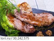 Купить «Delicious roasted pork chop», фото № 30242575, снято 24 августа 2019 г. (c) Яков Филимонов / Фотобанк Лори