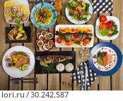 Купить «Top view of meals from trout and dog cockles», фото № 30242587, снято 26 марта 2019 г. (c) Яков Филимонов / Фотобанк Лори