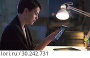 Купить «ui designer with tablet pc working at night office», видеоролик № 30242731, снято 28 февраля 2019 г. (c) Syda Productions / Фотобанк Лори