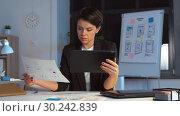Купить «ui designer with tablet pc working at night office», видеоролик № 30242839, снято 28 февраля 2019 г. (c) Syda Productions / Фотобанк Лори