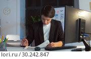 Купить «ui designer working on interface at night office», видеоролик № 30242847, снято 28 февраля 2019 г. (c) Syda Productions / Фотобанк Лори