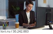 Купить «businesswoman drinking coffee at night office», видеоролик № 30242883, снято 28 февраля 2019 г. (c) Syda Productions / Фотобанк Лори
