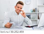 Купить «Business partner with smart phone and laptop», фото № 30252459, снято 14 декабря 2019 г. (c) Яков Филимонов / Фотобанк Лори