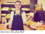 Купить «Female seller showing assortment», фото № 30252467, снято 23 ноября 2016 г. (c) Яков Филимонов / Фотобанк Лори