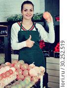 Купить «Shopping assistant demonstrating assortment of grocery shop», фото № 30252519, снято 23 ноября 2016 г. (c) Яков Филимонов / Фотобанк Лори