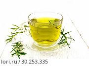 Чай из розмарина в чашке на доске. Стоковое фото, фотограф Резеда Костылева / Фотобанк Лори
