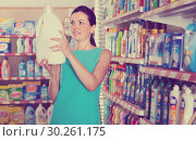 Купить «Pretty female want to buying softener in bottle», фото № 30261175, снято 6 июня 2017 г. (c) Яков Филимонов / Фотобанк Лори