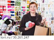 Купить «Woman holding shopping bags and accessories for knitting and embroidery», фото № 30261247, снято 10 мая 2017 г. (c) Яков Филимонов / Фотобанк Лори