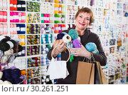 Купить «Client is standing with purchases», фото № 30261251, снято 10 мая 2017 г. (c) Яков Филимонов / Фотобанк Лори
