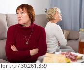 Купить «Frustrated elderly woman after quarrel with female friend», фото № 30261359, снято 22 ноября 2017 г. (c) Яков Филимонов / Фотобанк Лори