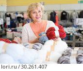 Купить «woman is considering a range thread», фото № 30261407, снято 20 декабря 2017 г. (c) Яков Филимонов / Фотобанк Лори