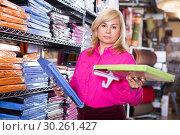 woman looking cotton bed sheet. Стоковое фото, фотограф Яков Филимонов / Фотобанк Лори