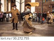 Купить «Man and woman dancing vintage dancing in retro costumes at the Maslenitsa festivities at Manezhnaya square in Moscow, Russia», фото № 30272755, снято 9 марта 2019 г. (c) Наталья Волкова / Фотобанк Лори