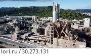 Купить «Aerial view of a huge cement plant with warehouses in Catalonia, Spain», видеоролик № 30273131, снято 21 ноября 2018 г. (c) Яков Филимонов / Фотобанк Лори