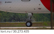Купить «Airplane taxiing to start before departure», видеоролик № 30273435, снято 30 ноября 2018 г. (c) Игорь Жоров / Фотобанк Лори