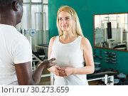 Купить «Man and woman talking at gym», фото № 30273659, снято 25 февраля 2019 г. (c) Яков Филимонов / Фотобанк Лори