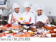 Купить «chefs offering fresh marine products for tasting», фото № 30273855, снято 26 января 2018 г. (c) Яков Филимонов / Фотобанк Лори