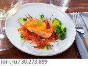 Купить «Roasted salmon steak on carrot brushwood with broccoli, cucumber, figs», фото № 30273899, снято 23 марта 2019 г. (c) Яков Филимонов / Фотобанк Лори