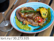 Купить «Grilled veal loin with guacamole and vegetables on wooden background», фото № 30273935, снято 27 июня 2018 г. (c) Яков Филимонов / Фотобанк Лори