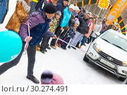 Купить «A man participates in the competition for the holiday Maslenitsa and drags a lightweight LADA car on a rope. City of Cheboksary, Russia, 03/10/2019.», фото № 30274491, снято 10 марта 2019 г. (c) Александр Якимов / Фотобанк Лори