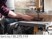 Купить «Construction worker cutting wooden board», фото № 30275119, снято 5 февраля 2019 г. (c) Jan Jack Russo Media / Фотобанк Лори