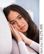 Купить «Young woman lying and melancholy», фото № 30275495, снято 30 мая 2017 г. (c) Яков Филимонов / Фотобанк Лори