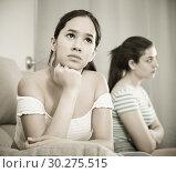 Купить «Quarreled girls apart on couch», фото № 30275515, снято 7 июня 2017 г. (c) Яков Филимонов / Фотобанк Лори