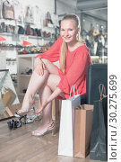 Купить «Customer is trying on sandals», фото № 30275699, снято 27 мая 2017 г. (c) Яков Филимонов / Фотобанк Лори