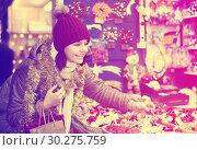 Купить «Happy teen girl shopping at festive fair», фото № 30275759, снято 12 декабря 2016 г. (c) Яков Филимонов / Фотобанк Лори