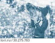 Купить «Happy teenage girl choosing christmas gifts», фото № 30275783, снято 22 декабря 2016 г. (c) Яков Филимонов / Фотобанк Лори