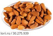 Купить «Handful of roasted almond nuts on a white surface», фото № 30275939, снято 24 июля 2019 г. (c) Яков Филимонов / Фотобанк Лори