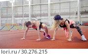 Купить «Two young athletic women doing sport exercises on their legs», видеоролик № 30276215, снято 23 марта 2019 г. (c) Константин Шишкин / Фотобанк Лори