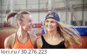 Купить «Two young athletic women friends running on a running track», видеоролик № 30276223, снято 21 марта 2019 г. (c) Константин Шишкин / Фотобанк Лори