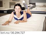 Купить «Female playfully posing and lying on soft mattress», фото № 30294727, снято 29 августа 2017 г. (c) Яков Филимонов / Фотобанк Лори