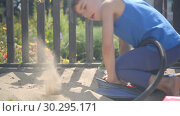 Купить «using a pump, a curious child modeled a volcano eruption in a sandbox», видеоролик № 30295171, снято 23 февраля 2019 г. (c) Ирина Мойсеева / Фотобанк Лори