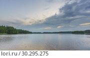 Купить «Timelapse of clouds over forest lake», видеоролик № 30295275, снято 10 марта 2019 г. (c) Sergey Borisov / Фотобанк Лори