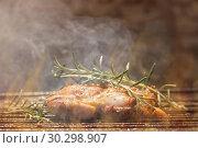 Купить «Grilled Deboned Chicken Meat On Smoking Barbecue With Rosemary.», фото № 30298907, снято 10 июня 2018 г. (c) easy Fotostock / Фотобанк Лори