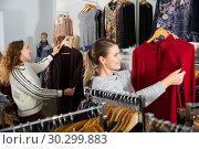 Купить «Women shopping in clothing boutique», фото № 30299883, снято 6 декабря 2018 г. (c) Яков Филимонов / Фотобанк Лори