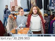 Купить «Women trying coat in clothing boutique», фото № 30299903, снято 6 декабря 2018 г. (c) Яков Филимонов / Фотобанк Лори