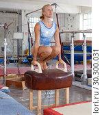 Купить «Happy beautiful woman gymnast training action at vaulting horse», фото № 30300031, снято 18 июля 2018 г. (c) Яков Филимонов / Фотобанк Лори