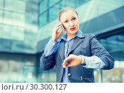 Купить «Portrait of busy female rushing to important meeting», фото № 30300127, снято 6 мая 2017 г. (c) Яков Филимонов / Фотобанк Лори